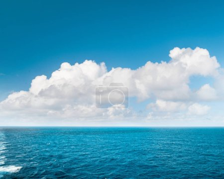Photo for Sea water and perfect blue sky with white clouds. Nature landscape - Royalty Free Image