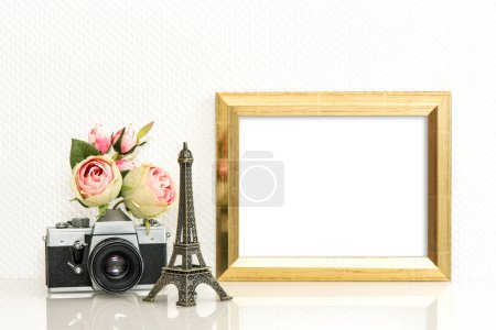 Photo for Golden picture frame, rose flowers and vintage camera. Paris travel concept - Royalty Free Image