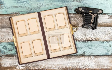 Photo for Antique photo camera and photo album for pictures on wooden background - Royalty Free Image