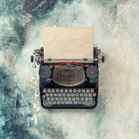 Photo for Vintage typewriter with grungy paper sheet. Retro style toned picture - Royalty Free Image