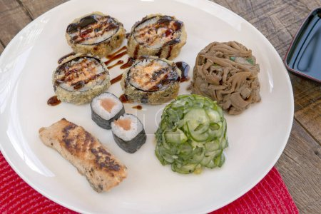 Photo for Dish with varied Japanese foods, made the Brazilian way. Sao Paulo city, Brazil - Royalty Free Image
