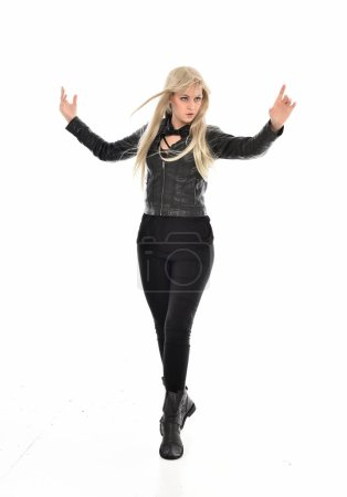 Photo for Full length portrait of blonde girl wearing black leather clothes, standing pose.  isolated on white studio background. - Royalty Free Image