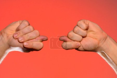 Man's hand with a fig's sign close-up is isolated ...