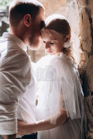 close-up portrait of attractive young cuddling bride and groom