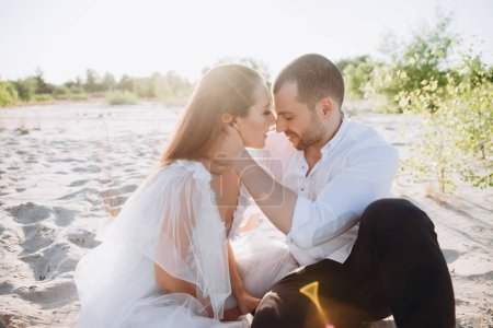 beautiful happy couple sitting on beach