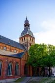 """Постер, картина, фотообои """"Городские сцены с городской улицы, здания и синий пасмурное небо в Риге, Латвия"""""""