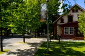 urban scene with green trees on street and buildings in Riga, Latvia