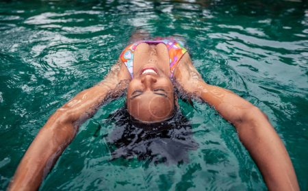 Photo for Afro american woman enjoying time in the swimming pool - Royalty Free Image