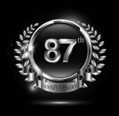 87 years silver anniversary celebration logo with ring and ribbon laurel wreath design