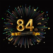 84 years golden  anniversary logo with firework on black background
