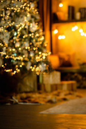 Photo for Home background. Reading corner near the fireplace and Christmas tree with gifts. Blurred. - Royalty Free Image