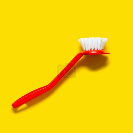 Photo for Bright red brush lies on a bright yellow background. In the style of pop art. Top view. Copy space. - Royalty Free Image