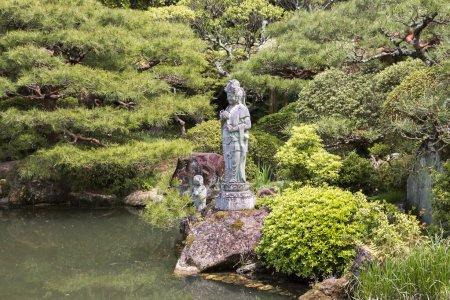 Sendai, Japan, 04/29/2017, Garden in Rinnoji temple. Buddhist temple with a beautiful garden and pagoda. At the pond is a statue of the goddess of Mercy.