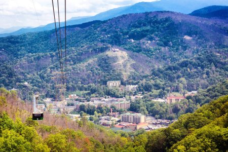 GATLINBURG, TENNESSEE, USA - SEPTEMBER 5, 2018: Cable car at Ober Gatlinburg takes tourists on scenic ride over Smokey Mountain National Park to visit the mountaintop