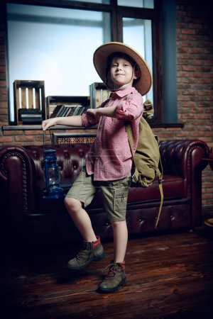 Child boy playing at home in traveler. Childhood. Fantasy, imagination.