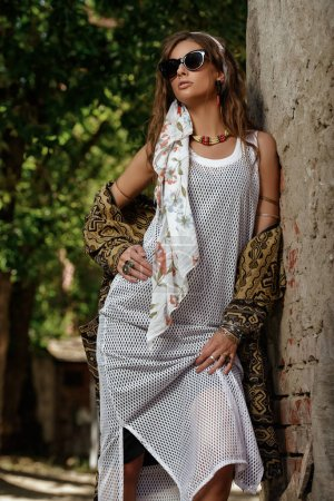 Photo for Female style. Feminine fashion model posing in boho style clothes on a street. Outdoor fashion. - Royalty Free Image