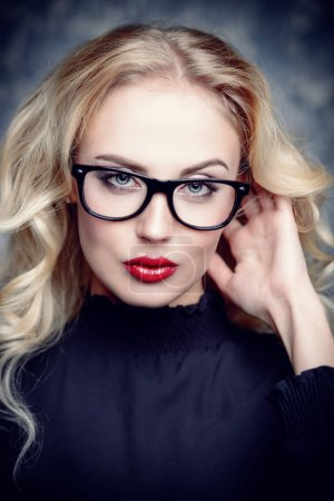 Photo for Beauty portrait. Attractive young woman in glasses with bright make-up. Optics style. Cosmetics and make-up. - Royalty Free Image