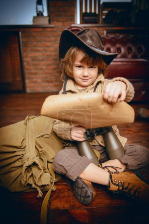 Cute child boy playing at home in traveler. Childhood. Fantasy, imagination.
