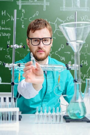 Smartman scientist making chemical experiments in the laboratory. Educational concept.