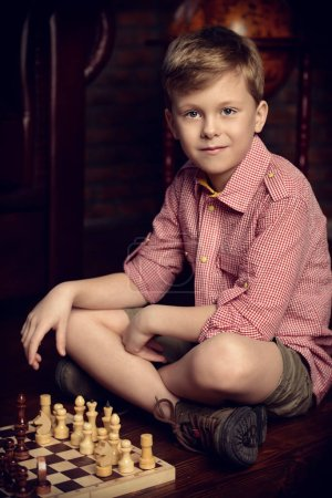 Photo for Little boy playing chess at home. Games and activities for children. Family concept. - Royalty Free Image