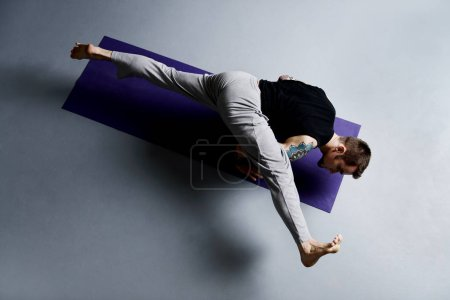 Photo for Various difficult yoga poses. Yoga teacher doing exercises on yoga. - Royalty Free Image