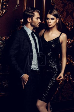Photo for Sexual passionate couple in elegant evening dresses. Luxurious interior. Fashion shot. - Royalty Free Image