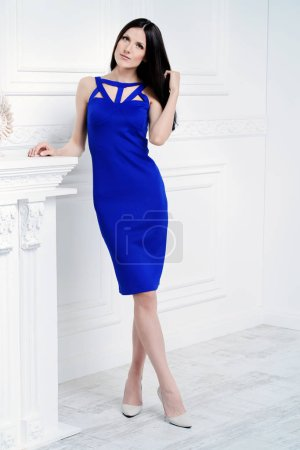 Photo for Attractive young woman posing in elegant blue dress. Beauty, fashion. - Royalty Free Image