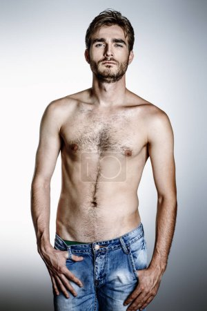Portrait of a brutal handsome man with naked torso. Male beauty, health.