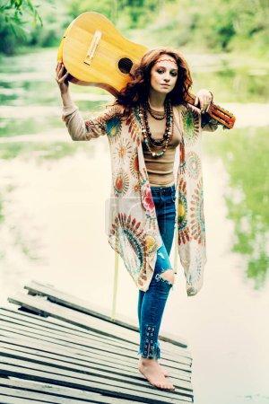 Beautiful hippie girl posing outdoor. Contemporary bohemian style. Spirit of freedom. Fashion shot. Bohemian, bo-ho style.