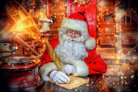 Photo for Portrait of Santa Claus writing a letter. Christmas and New Year concept. - Royalty Free Image