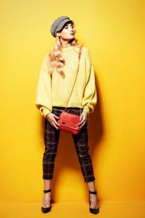 Fashionable bright lady posing in studio. Fashion for women.