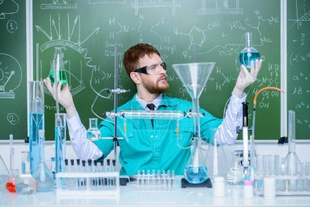 Photo for Smart man scientist making chemical experiments in the laboratory. Educational concept. Discovery. - Royalty Free Image