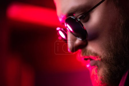 Photo for A close up portrait of a stylish man wearing sunglasses. Beauty and style for men. - Royalty Free Image
