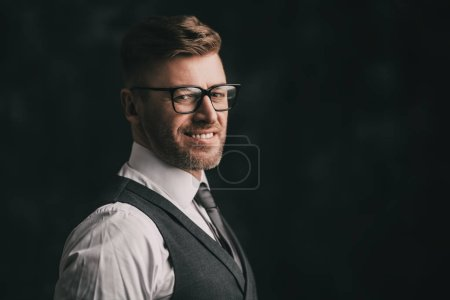 Photo for A portrait of a handsome brutal mature man posing in the studio. Casual formal fashion, men's beauty. - Royalty Free Image