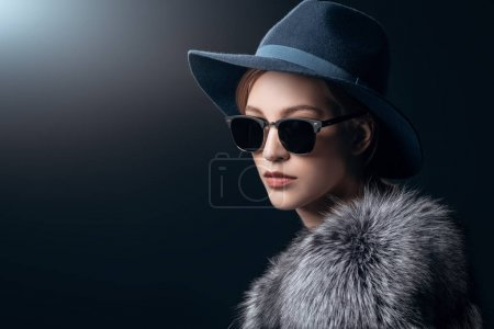 Photo for A close-up portrait of a young fashionable woman in a fur coat and sunglasses. Beauty, optics, fashion. - Royalty Free Image