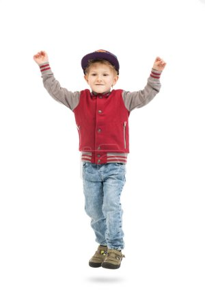 Photo for A full length portrait of a happy young schoolboy posing in the studio over the white background. Kids casual fashion, education. - Royalty Free Image