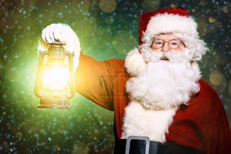 Photo for A portrait of Santa Claus holding a lantern. Merry Christmas and Happy New Year! - Royalty Free Image