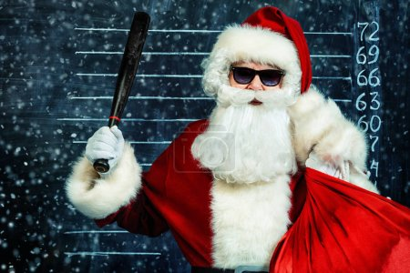 Photo for A portrait of criminal Santa Claus in sunglasses. Merry Christmas and Happy New Year! - Royalty Free Image
