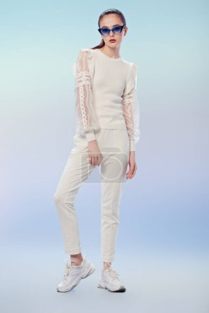 Photo for Beautiful summer girl posing in elegant white clothes and sunglasses on a light blue background. Summer fashion and makeup. - Royalty Free Image