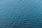 Ripples on the surface of blue water of the Black Sea top view of a natural background