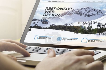 online business concept: man using a laptop with responsive web design website on the screen. Screen graphics are made up.