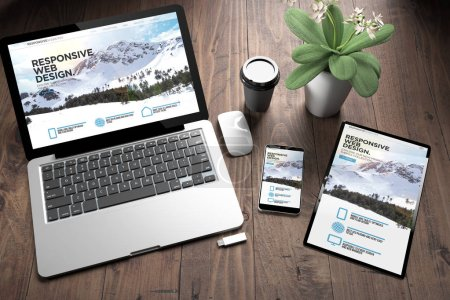 3d rendering of three devices with responsive website on screen on wooden desktop top view