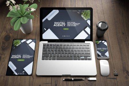 3d rendering of devices on wooden floor showing digital agency responsive website