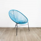 light blue acapulco chair on white wall background