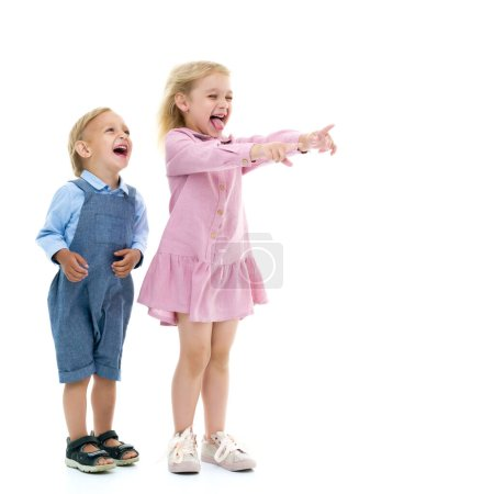Photo for Wind blows on boy and girl.Brother and sister, girl and boy rejoices in the wind that blows in their face. Concept game, happy childhood. Isolated on white background. - Royalty Free Image