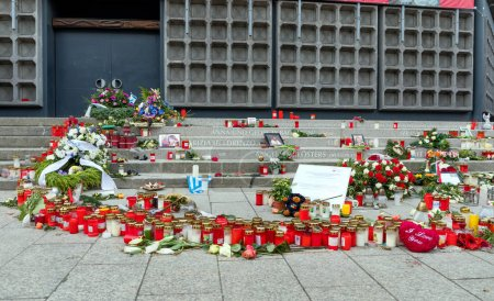 BERLIN, GERMANY - JANUARY 1, 2018: Candles, flowers and condolence messages at Christmas Market in Berlin.  On 19 December 2016, a truck was deliberately driven into the Christmas market.