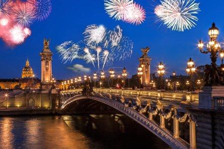Alexandre III bridge with firework in Paris, France