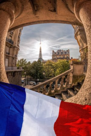 Photo for Romantic street view with Eiffel Tower against french flag in Paris, France - Royalty Free Image
