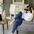 Attractive young woman adjusting her VR headset...