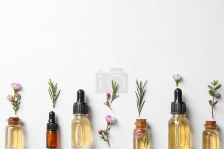 Flat lay composition with bottles of natural tea t...